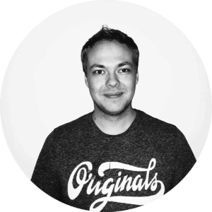 Black and white headshot of developer Tobias